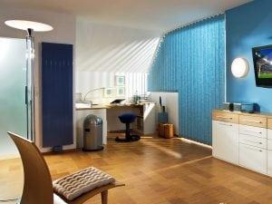 Панельные вертикальные радиаторы отопления в интерьере квартиры