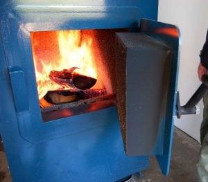 Устройство котла длительного горения на дровах